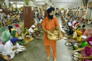Pilgrims enjoying enjoying tasty food ( free of cost )